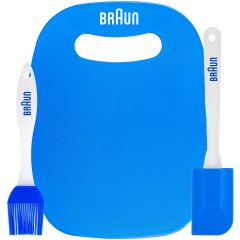A blue and white basting brush with a blue logo beside a blue cutting board with a white logo. Beside these is a blue and white spatula with a blue logo