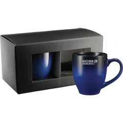Two blue gradient 14oz ceramic mugs one outside it's gift box with a white logo and the other unbranded still inside the gift box