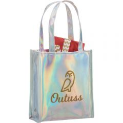 An angled view of a holographic gift tote with a gold logo on the front. Inside the tote there is a gift with red wrapping paper covering it