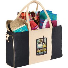 An angled view of a black and natural coloured jute and cotton tote with a full colour logo and filled with goods