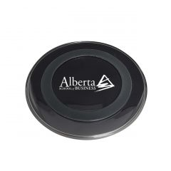 black circle shaped wireless charge pad with white logo
