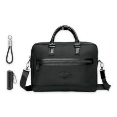blank black executive briefcase with a black powerbank and a charger keyring next to it