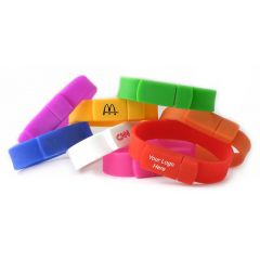 eight different coloured silicone USB wristbands with custom branded logos