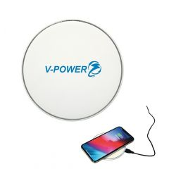 white circle shaped wireless phone charger with example of use in corner