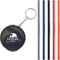 black straw keychain with white print and five different coloured silicone straws beside to it