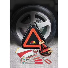 A black and orange triangular car safety kit in front of a tire with the contents shown in front of it