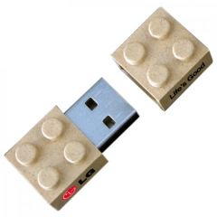 beige building block USB drive in the open position with black and red print