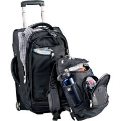 black 22inch wheeled carry on with a slightly unzipped black removable day pack in front of it