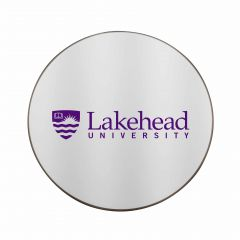 silver coloured circle shaped wireless charge pad with purple logo