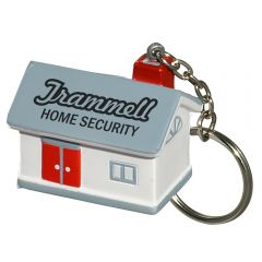 A grey and white coloured house shaped stress reliever on a metal keychain with a metal split ring attached