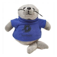 "The front view of a 6"" seal plush wearing a blue T-shirt with a black logo on it"