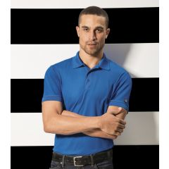 A man wearing an electric blue polo shirt with his arms folded in front of a black and white horizontally striped background
