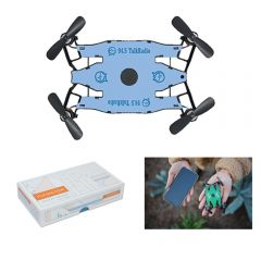 A black selfie drone with a light blue middle and a dark blue logo in the center. The drone is above a white and orange box on the lower left and a lifestyle image of a hand holding another drone to the right of this