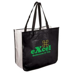 white and black extra large shopper with green and orange logo and black handles
