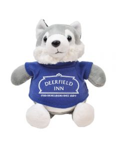 "The front view of a 6"" husky Plush wearing a blue T-shirt with a white logo on it"